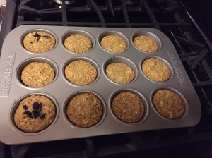 Muffins in the pan -  two of them are raisin-topped for a raising-loving friend!