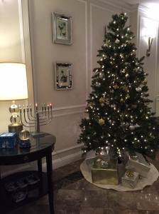 Christmas tree and menorah side by side for Chrismukkah