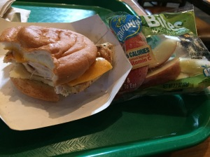 Gluten-free grilled chicken sandwich and apple slices